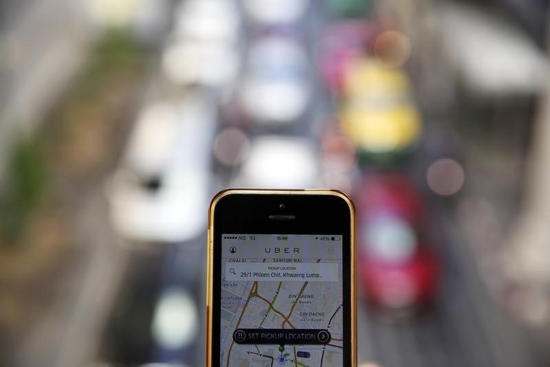 ImageFile: Uber resumes service with new rules, appeals huge fine