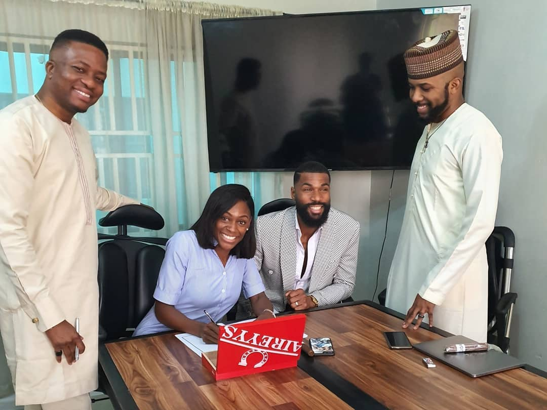 Photo: Ex-BBNaija housemate, Mike, wife sign endorsement deal with Banky W's EME